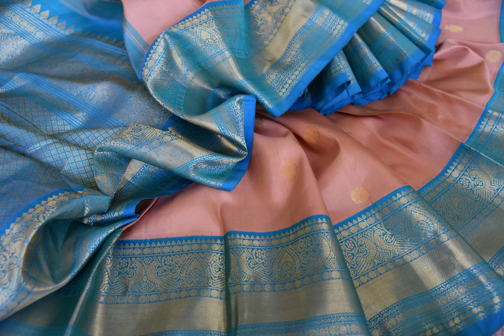 Buy beautiful dusty pink Kanjivaram saree online in USA with blue zari border and zari buta. Go for rich traditional festive look with beautiful Kanchipuram silk sarees, soft silk sarees, Banarasi silk saris from Pure Elegance Indian cloth store in USA. -details