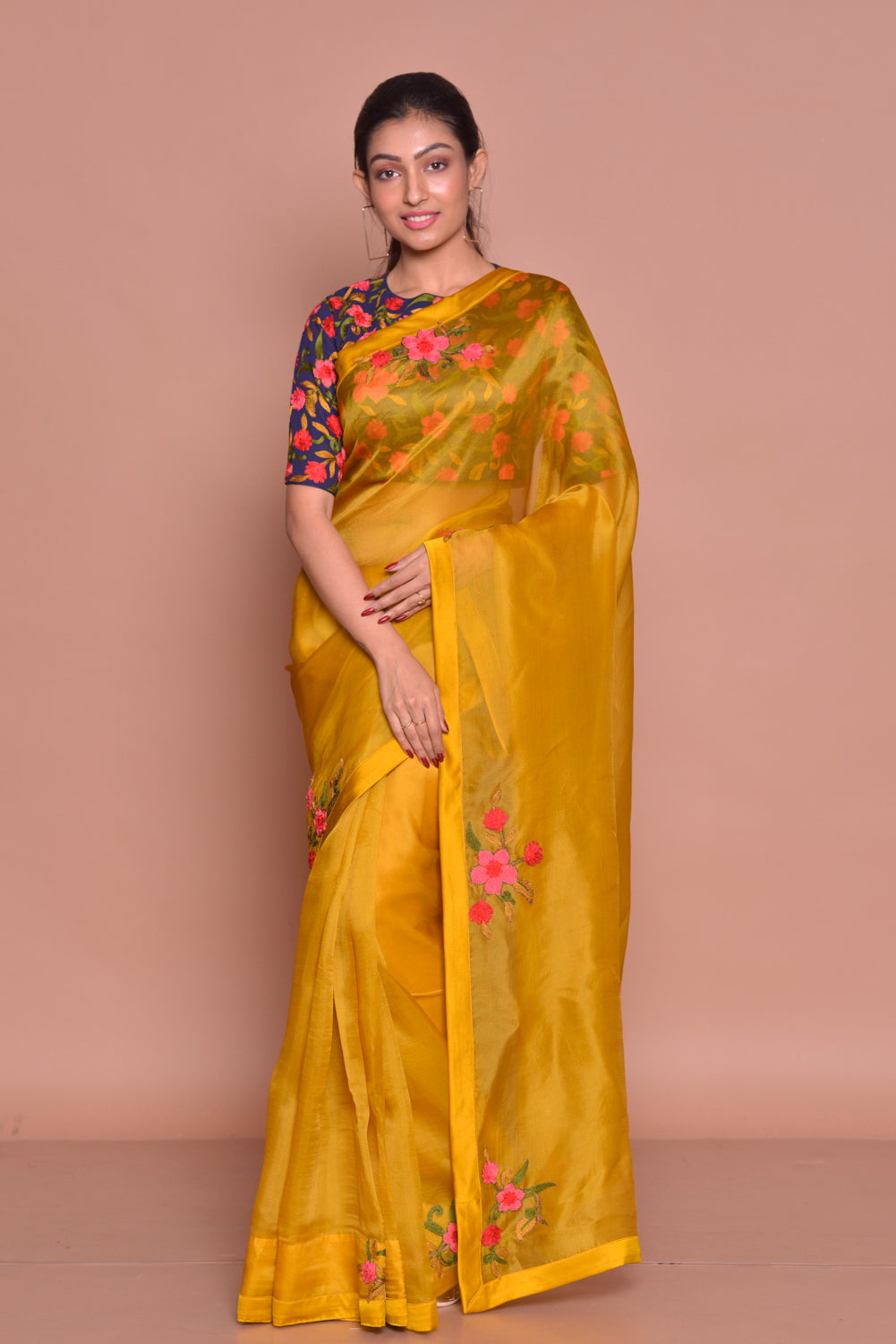 Buy beautiful mustard embroidered organza saree online in USA with blue floral saree blouse. Set ethnic fashion goals with exquisite silk sarees with blouse, Banarasi sarees, Kanchipuram saris from Pure Elegance Indian luxury clothing store in USA.-full view