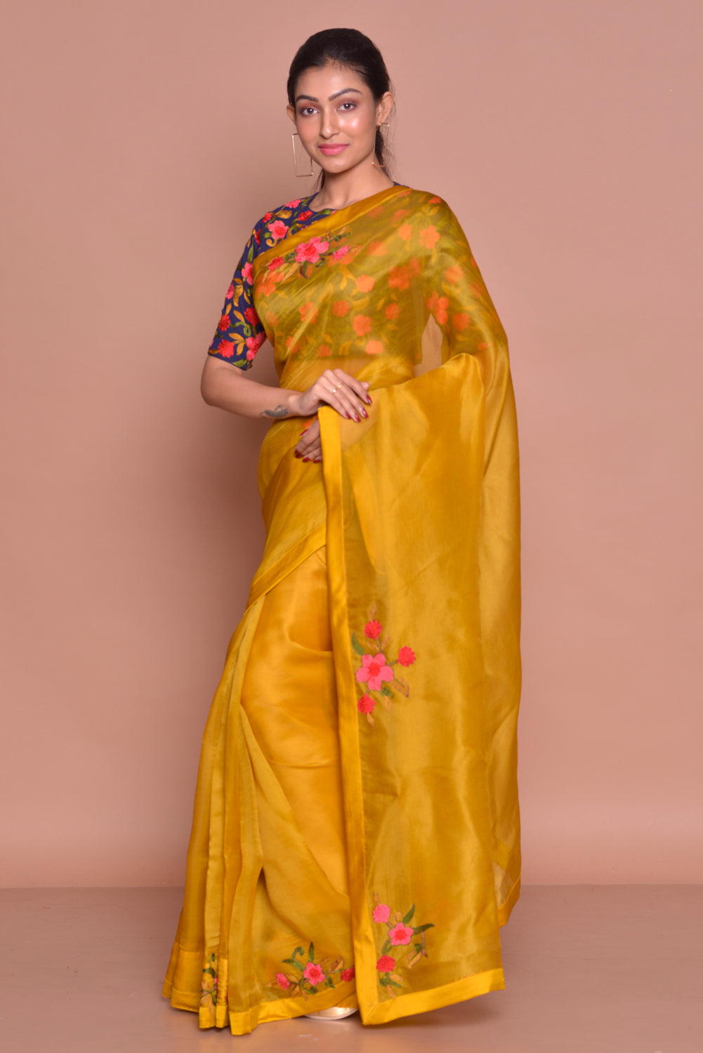 Buy beautiful mustard embroidered organza saree online in USA with blue floral saree blouse. Set ethnic fashion goals with exquisite silk sarees with blouse, Banarasi sarees, Kanchipuram saris from Pure Elegance Indian luxury clothing store in USA.-side