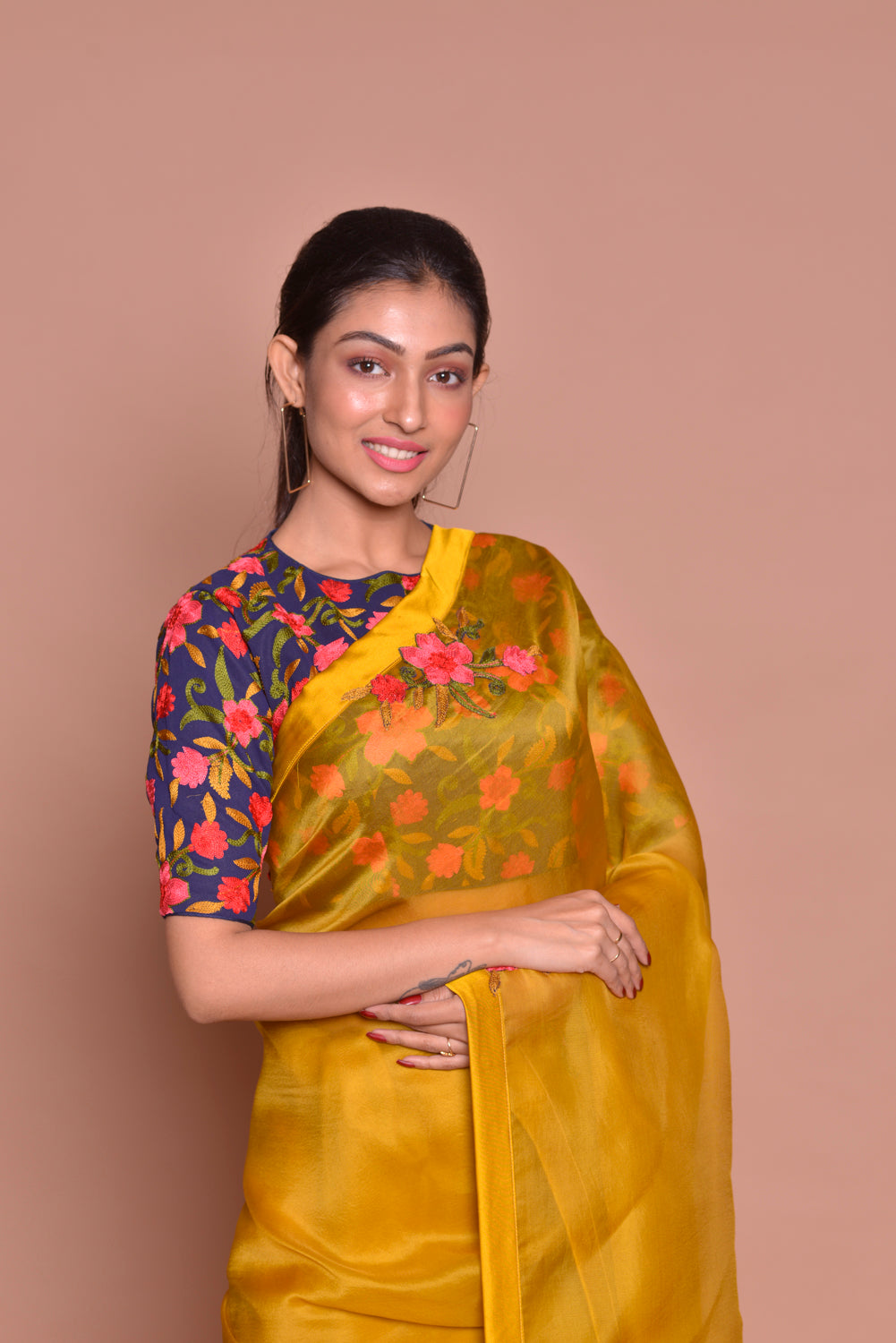 Buy beautiful mustard embroidered organza saree online in USA with blue floral saree blouse. Set ethnic fashion goals with exquisite silk sarees with blouse, Banarasi sarees, Kanchipuram saris from Pure Elegance Indian luxury clothing store in USA.-closeup