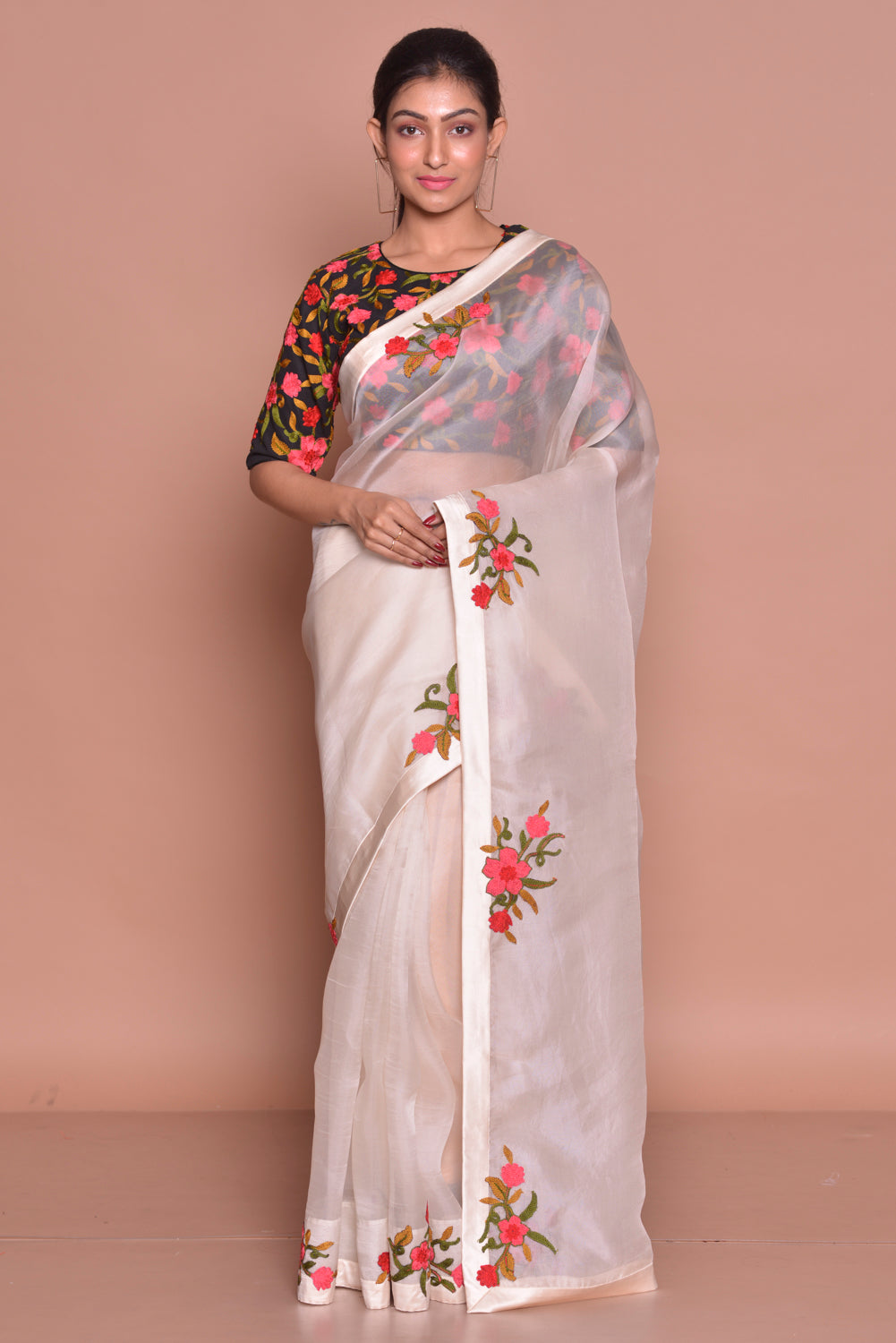 Buy off-white embroidered organza sari online in USA with black floral saree blouse. Set ethnic fashion goals with exquisite silk sarees with blouse, Banarasi sarees, Kanchipuram saris from Pure Elegance Indian luxury clothing store in USA.-full view