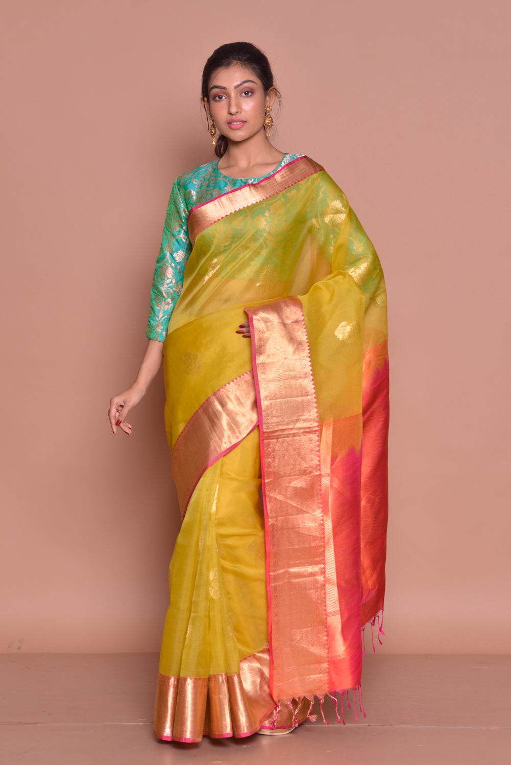 Shop yellow kora Banarasi saree online in USA with red zari pallu and green Banarasi sari blouse. Set ethnic fashion goals with exquisite designer sarees with blouse, Banarasi sarees, Kanchipuram saris from Pure Elegance Indian luxury clothing store in USA.-full view