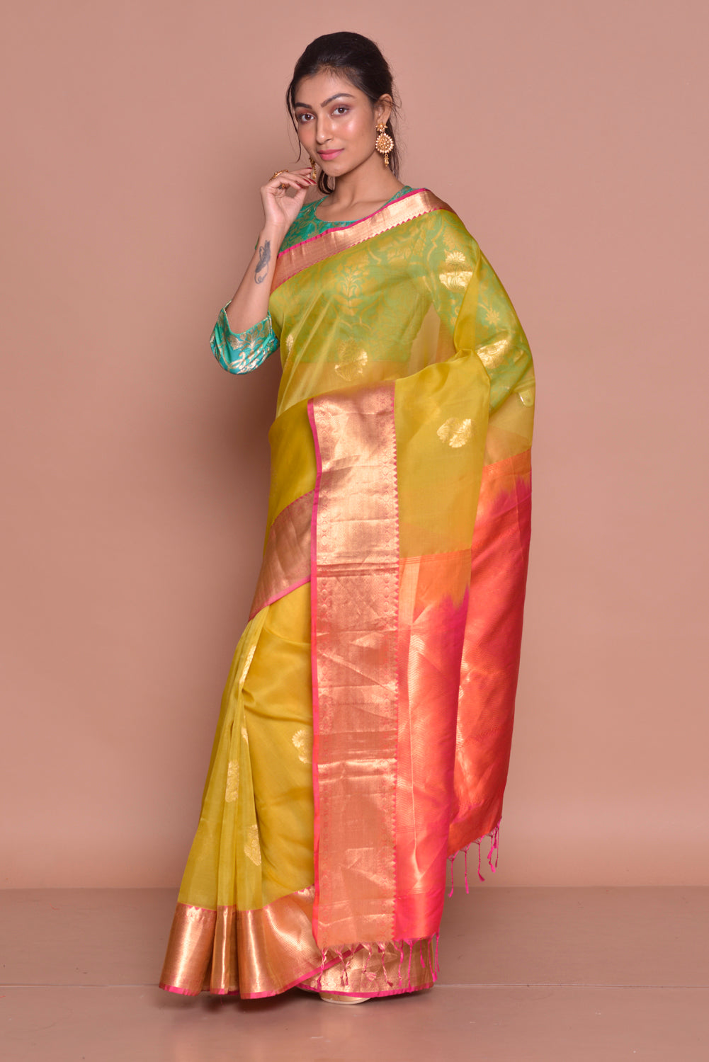 Shop yellow kora Banarasi saree online in USA with red zari pallu and green Banarasi sari blouse. Set ethnic fashion goals with exquisite designer sarees with blouse, Banarasi sarees, Kanchipuram saris from Pure Elegance Indian luxury clothing store in USA.-side