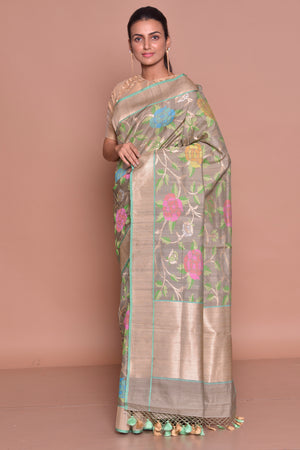 Buy alluring grey floral Banarasi silk saree online in USA with zari border and beige embroidered sari blouse. Set ethnic fashion goals with exquisite designer sarees with blouse, Banarasi sarees, Kanchipuram saris from Pure Elegance Indian luxury clothing store in USA.-side