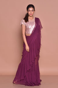 Shop contemporary purple georgette ruffle saree online in USA with pink sequin sari blouse. Set ethnic fashion goals with exquisite designer sarees with blouse, Banarasi sarees, Kanchipuram saris from Pure Elegance Indian luxury clothing store in USA.-full view