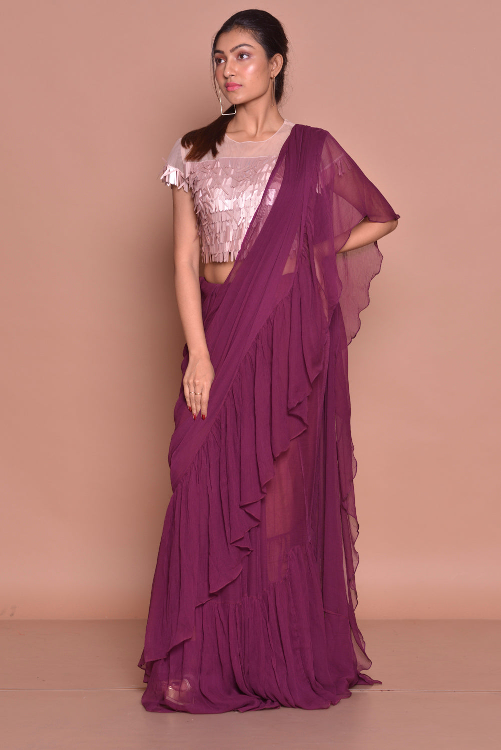 Shop contemporary purple georgette ruffle saree online in USA with pink sequin sari blouse. Set ethnic fashion goals with exquisite designer sarees with blouse, Banarasi sarees, Kanchipuram saris from Pure Elegance Indian luxury clothing store in USA.-side