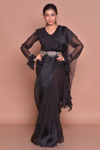 Buy black georgette ruffle saree with belt online in USA with matching sari blouse. Set ethnic fashion goals with exquisite designer sarees with blouse, Banarasi sarees, Kanchipuram saris from Pure Elegance Indian luxury clothing store in USA.-front