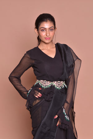 Buy black georgette ruffle saree with belt online in USA with matching sari blouse. Set ethnic fashion goals with exquisite designer sarees with blouse, Banarasi sarees, Kanchipuram saris from Pure Elegance Indian luxury clothing store in USA.-closeup
