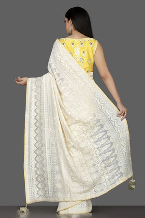 Shop beautiful off-white Lucknowi georgette saree online in USA with yellow embroidered saree blouse. Spread ethnic elegance on weddings and special occasions in splendid designer sarees with blouses, embroidered saris crafted with exquisite Indian craftsmanship from Pure Elegance Indian fashion store in USA.-back