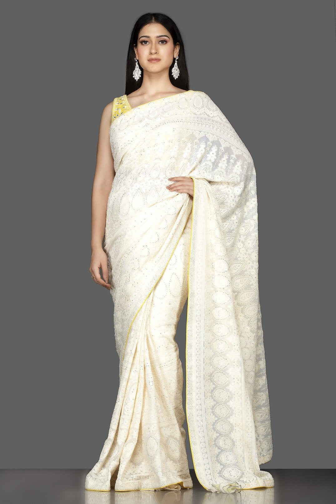 Shop beautiful off-white Lucknowi georgette saree online in USA with yellow embroidered saree blouse. Spread ethnic elegance on weddings and special occasions in splendid designer sarees with blouses, embroidered saris crafted with exquisite Indian craftsmanship from Pure Elegance Indian fashion store in USA.-full view