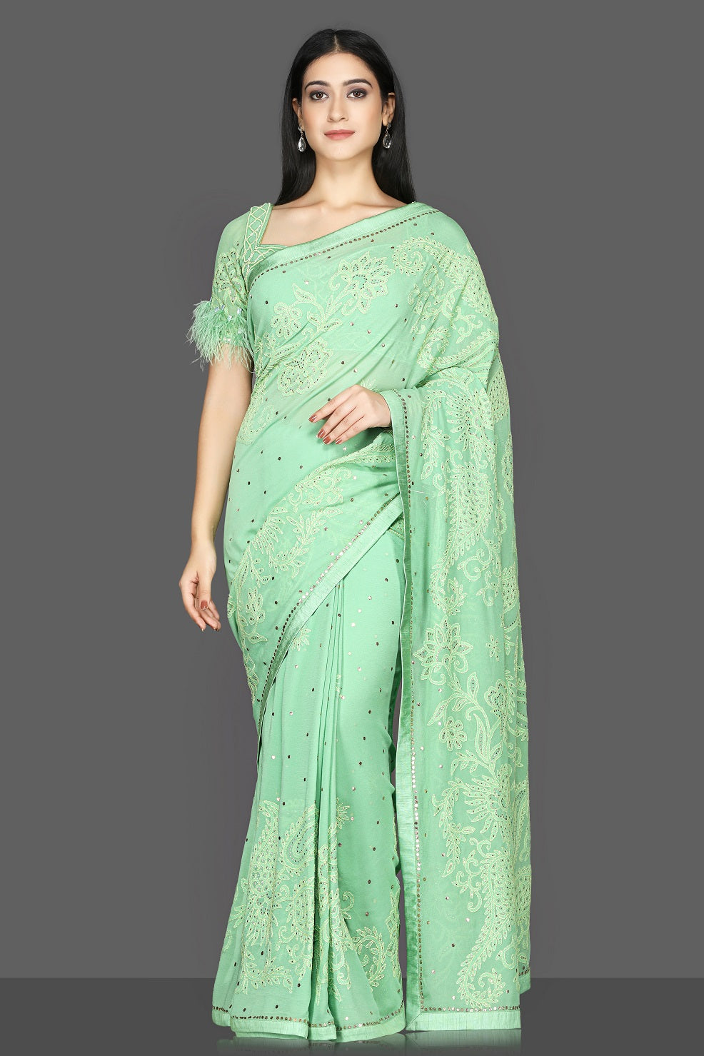 Shop stunning pastel green Lucknowi hand embroidery georgette sari online in USA with fur sleeves embroidered saree blouse. Flaunt ethnic fashion with exquisite designer sarees with blouse. embroidered sarees, pure silk sarees from Pure Elegance Indian fashion boutique in USA.-full view
