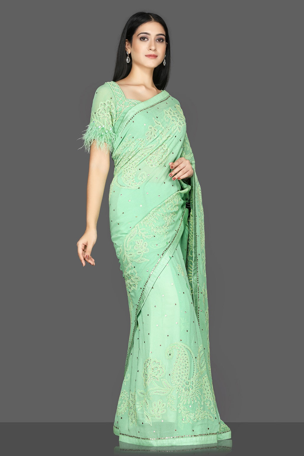 Shop stunning pastel green Lucknowi hand embroidery georgette sari online in USA with fur sleeves embroidered saree blouse. Flaunt ethnic fashion with exquisite designer sarees with blouse. embroidered sarees, pure silk sarees from Pure Elegance Indian fashion boutique in USA.-side