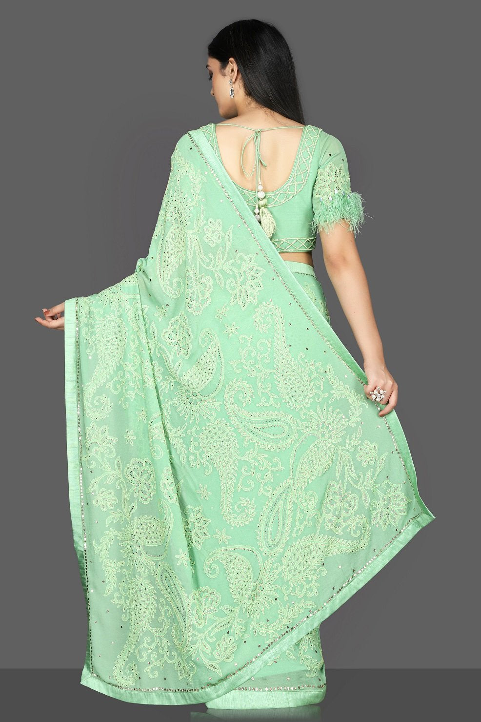 Shop stunning pastel green Lucknowi hand embroidery georgette sari online in USA with fur sleeves embroidered saree blouse. Flaunt ethnic fashion with exquisite designer sarees with blouse. embroidered sarees, pure silk sarees from Pure Elegance Indian fashion boutique in USA.-back