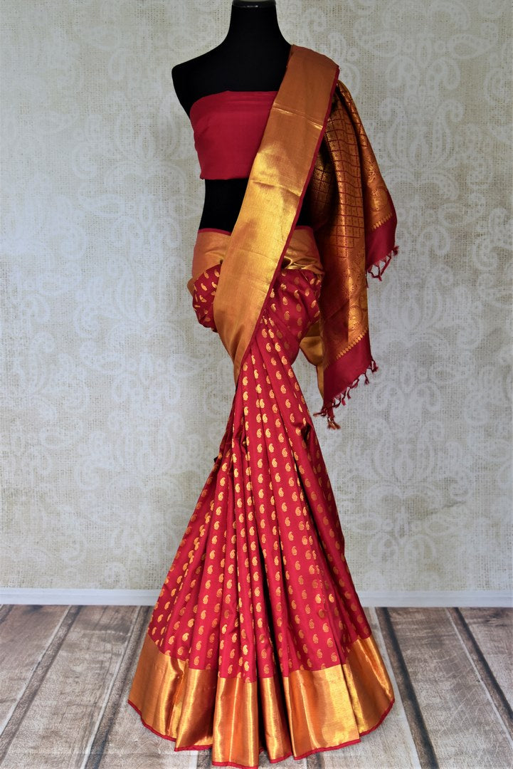 Shop red Kanchipuram silk saree online in USA with overall golden zari paisley buta. Look beautiful on weddings with exquisite Kanjivaram sarees from Pure Elegance Indian fashion store in USA. Get spoiled for choices with a myriad of pure silk sarees, Kanjeevaram saris available online.-full view