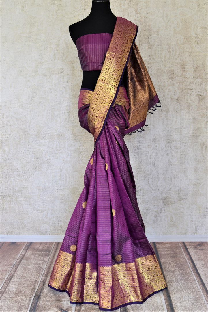Buy purple striped Kanjivaram saree online in USA with zari border and buta. Add spark to your festive style with beautiful Kanchipuram silk sarees in USA from Pure Elegance Indian fashion store.-full view