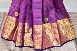 Buy purple striped Kanjivaram saree online in USA with zari border and buta. Add spark to your festive style with beautiful Kanchipuram silk sarees in USA from Pure Elegance Indian fashion store.-pleats