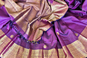 Buy purple striped Kanjivaram saree online in USA with zari border and buta. Add spark to your festive style with beautiful Kanchipuram silk sarees in USA from Pure Elegance Indian fashion store.-details