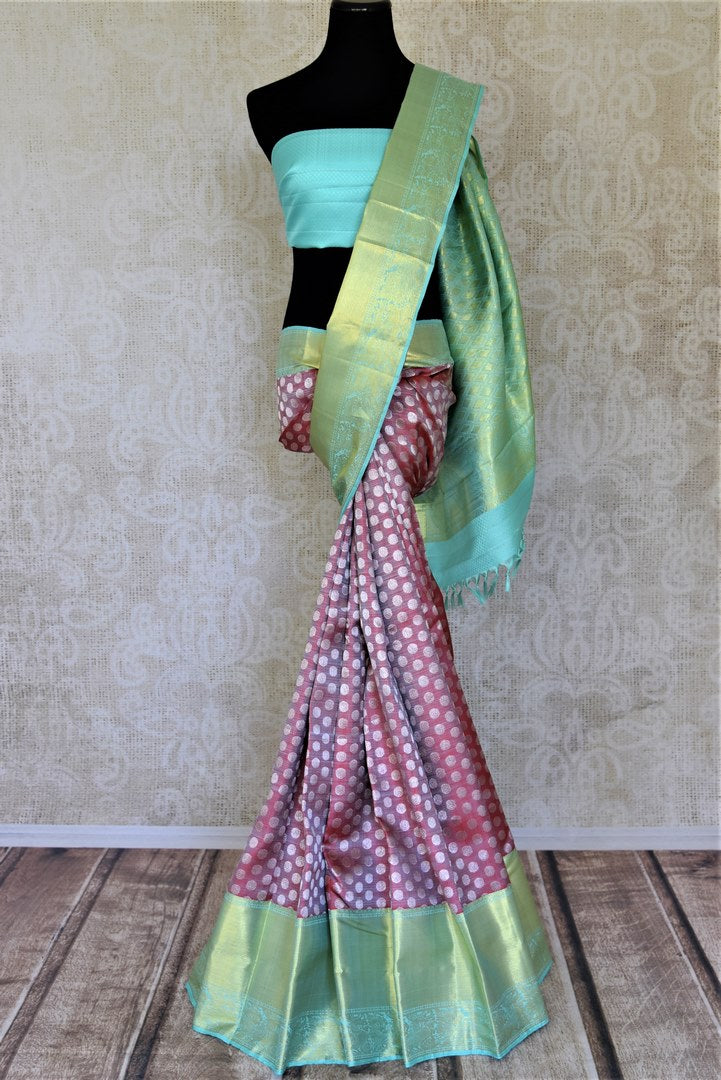 Buy beautiful pink Kanchipuram saree online in USA with pastel green zari border and zari buta. Add spark to your festive style with beautiful Kanchipuram silk sarees in USA from Pure Elegance Indian fashion store.-full view