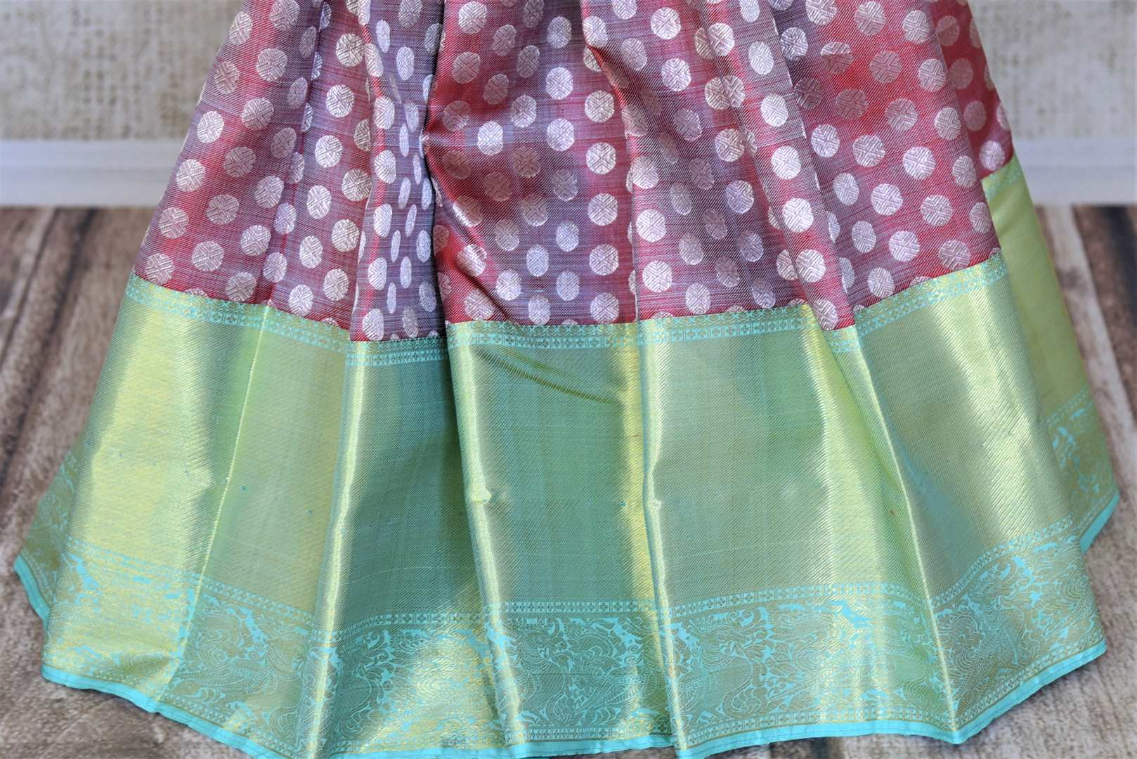 Buy beautiful pink Kanchipuram saree online in USA with pastel green zari border and zari buta. Add spark to your festive style with beautiful Kanchipuram silk sarees in USA from Pure Elegance Indian fashion store.-pleats