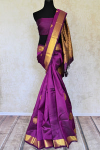 Buy attractive purple Kanjivaram sari online in USA with golden zari border and zari buta. Add spark to your festive style with beautiful Kanchipuram silk sarees in USA from Pure Elegance Indian fashion store.-full view
