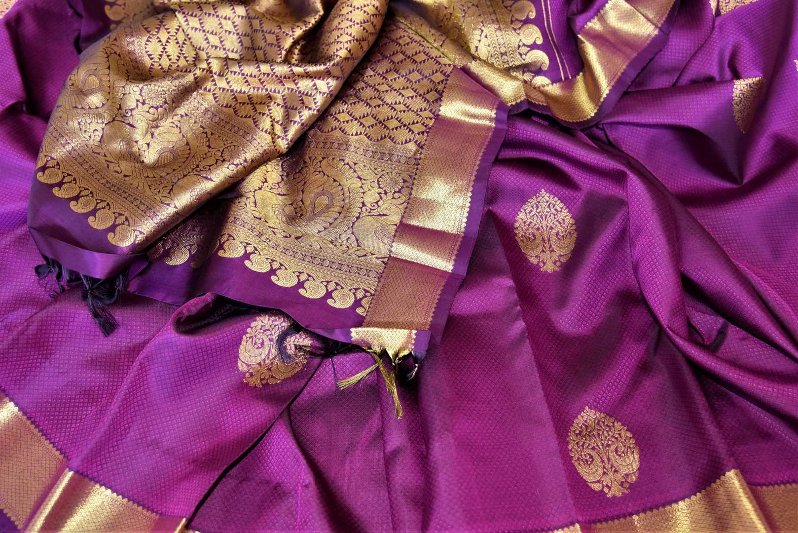 Buy attractive purple Kanjivaram sari online in USA with golden zari border and zari buta. Add spark to your festive style with beautiful Kanchipuram silk sarees in USA from Pure Elegance Indian fashion store.-details