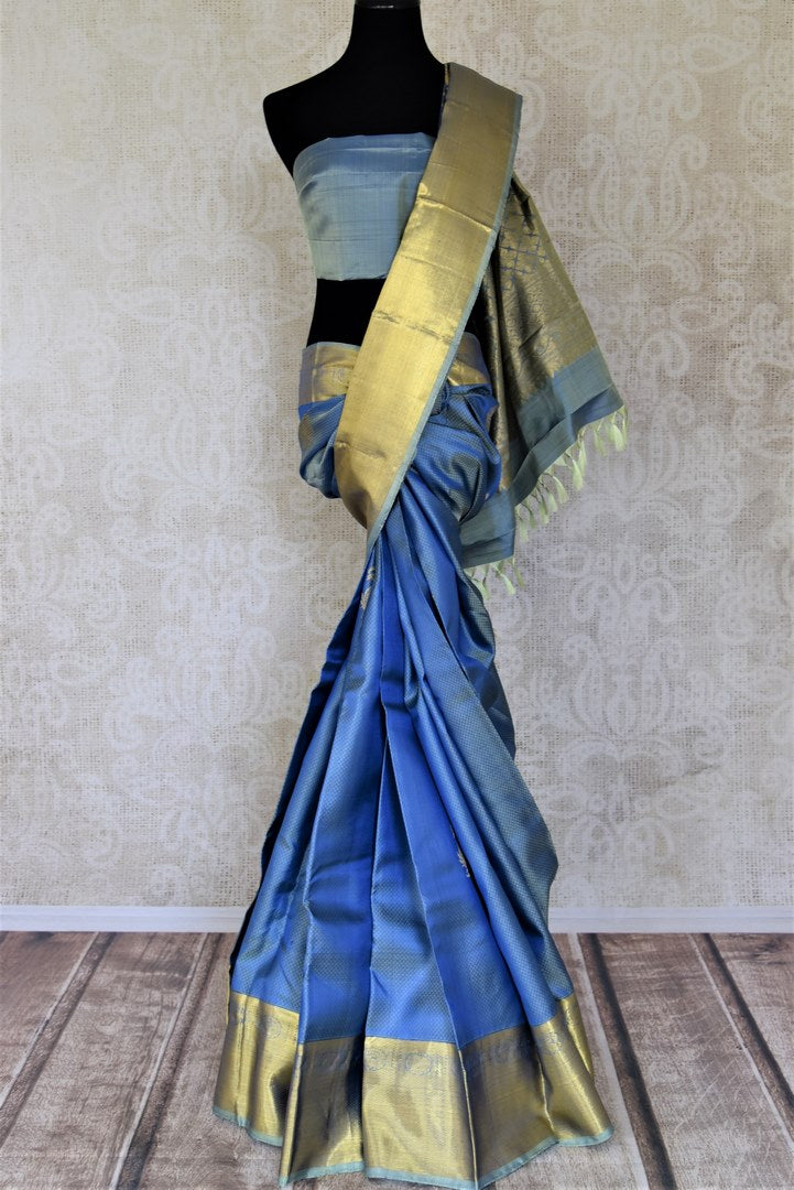 Shop lovely light blue Kanjivaram saree online in USA with golden zari border and zari buta. Add spark to your festive style with beautiful Kanchipuram silk sarees in USA from Pure Elegance Indian fashion store.-full view