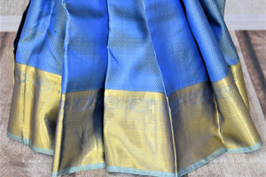 Shop lovely light blue Kanjivaram saree online in USA with golden zari border and zari buta. Add spark to your festive style with beautiful Kanchipuram silk sarees in USA from Pure Elegance Indian fashion store.-pleats