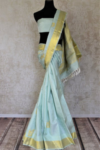 Buy gorgeous powder blue Kanjeevaram saree online in USA with peacock zari buta and golden zari border. Add spark to your festive style with beautiful Kanchipuram silk sarees in USA from Pure Elegance Indian fashion store.-full view