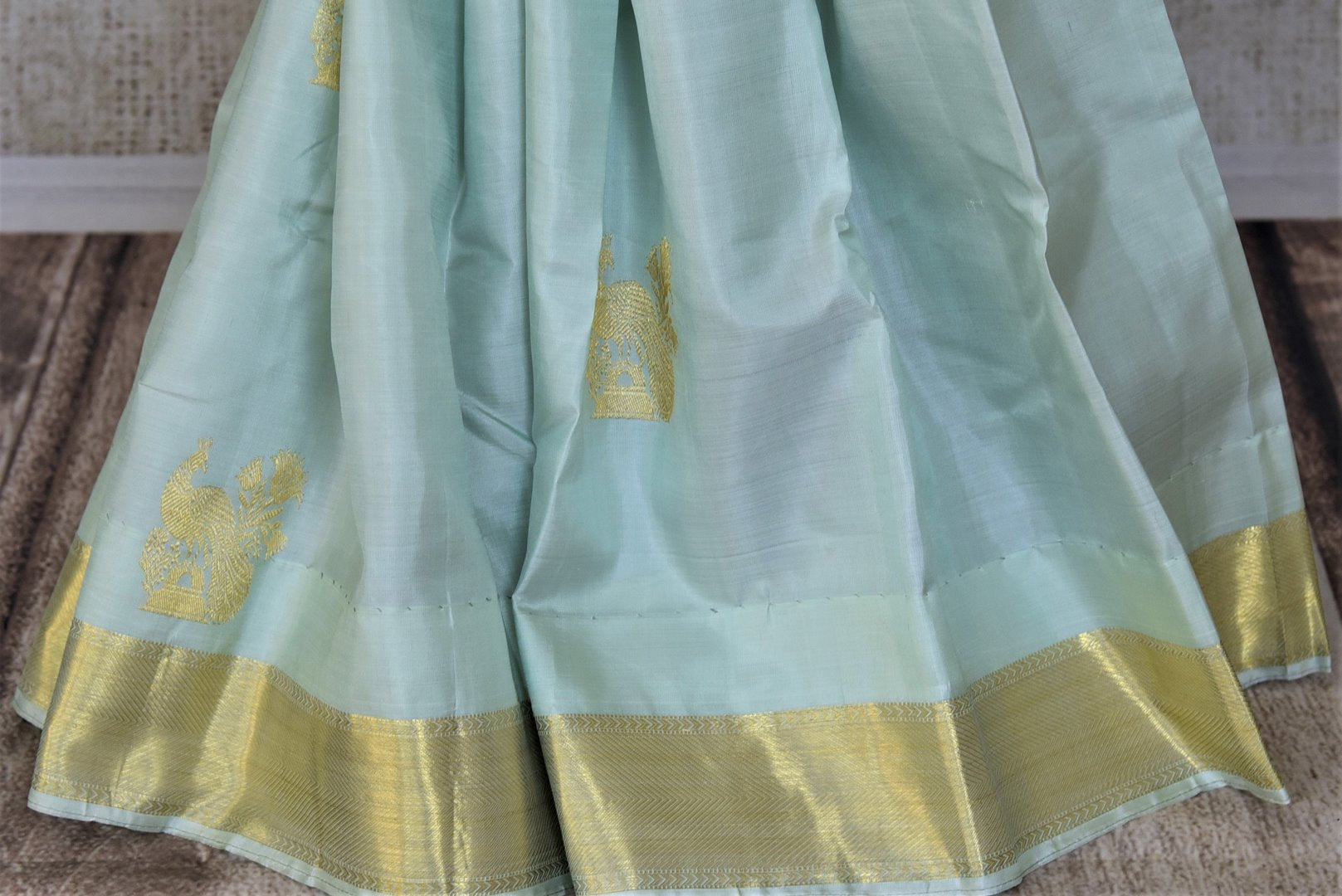 Buy gorgeous powder blue Kanjeevaram saree online in USA with peacock zari buta and golden zari border. Add spark to your festive style with beautiful Kanchipuram silk sarees in USA from Pure Elegance Indian fashion store.-pleats
