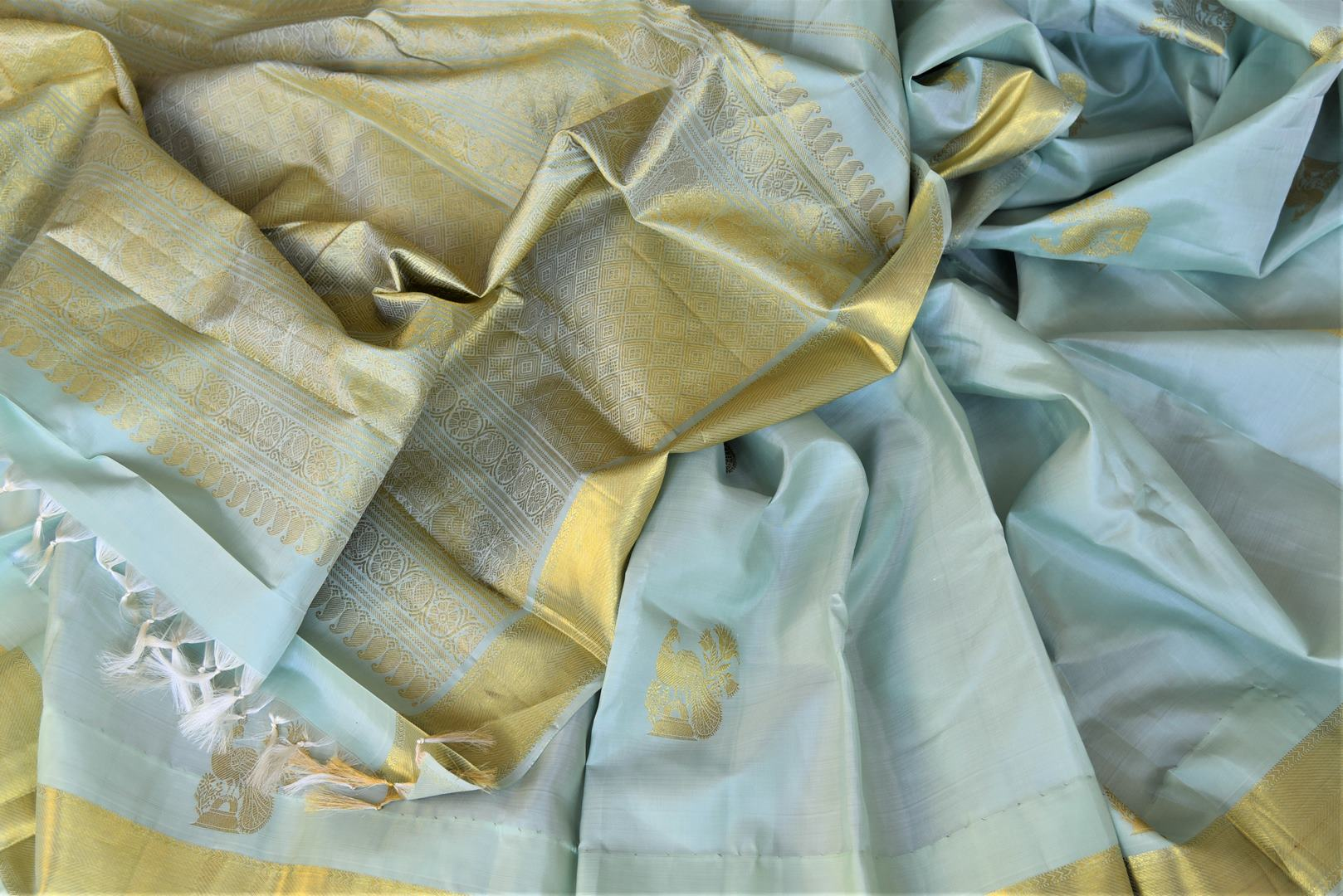 Buy gorgeous powder blue Kanjeevaram saree online in USA with peacock zari buta and golden zari border. Add spark to your festive style with beautiful Kanchipuram silk sarees in USA from Pure Elegance Indian fashion store.-details