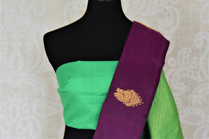 Buy gorgeous purple borderless Kanchipuram sari online in USA with zari buta and green zari pallu. Add spark to your festive style with beautiful Kanchipuram silk saris in USA from Pure Elegance Indian fashion store.-blouse pallu