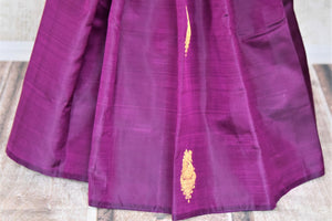Buy gorgeous purple borderless Kanchipuram sari online in USA with zari buta and green zari pallu. Add spark to your festive style with beautiful Kanchipuram silk saris in USA from Pure Elegance Indian fashion store.-pleats