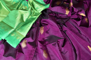 Buy gorgeous purple borderless Kanchipuram sari online in USA with zari buta and green zari pallu. Add spark to your festive style with beautiful Kanchipuram silk saris in USA from Pure Elegance Indian fashion store.-details