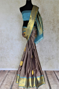 Buy stunning dark grey Kanjivaram sari online in USA with blue zari border. Look beautiful on weddings with exquisite Kanjivaram sarees from Pure Elegance Indian fashion store in USA. Get spoiled for choices with a myriad of pure silk sarees, Kanjeevaram saris available online.-full view
