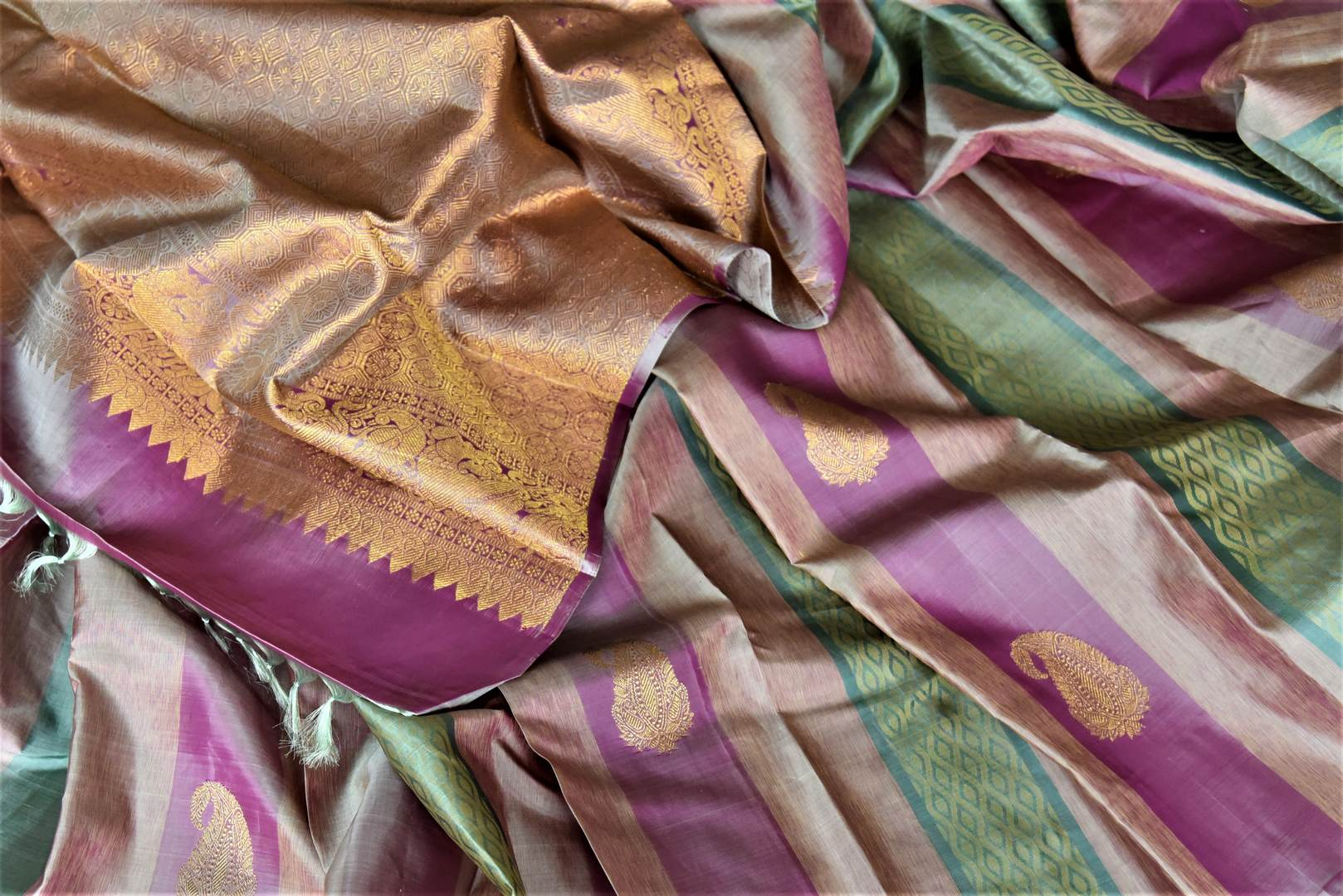 Buy beautiful multicolor stripes Kanjivaram saree with paisley zari buta. Give yourself a beautiful traditional makeover this wedding season with exquisite Kanchipuram silk sarees from Pure Elegance Indian fashion boutique in USA.-details