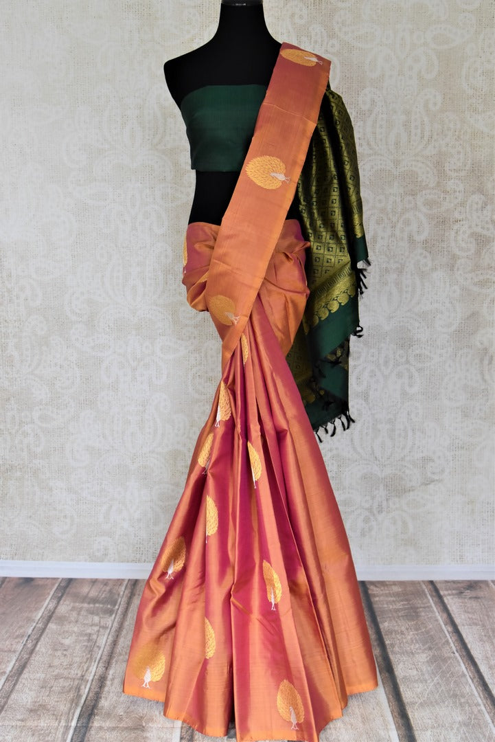 Shop beautiful golden orange borderless Kanchipuram saree online in USA with zari peacock buta and green zari pallu. Add spark to your festive style with beautiful Kanchipuram silk saris in USA from Pure Elegance Indian fashion store.-full view