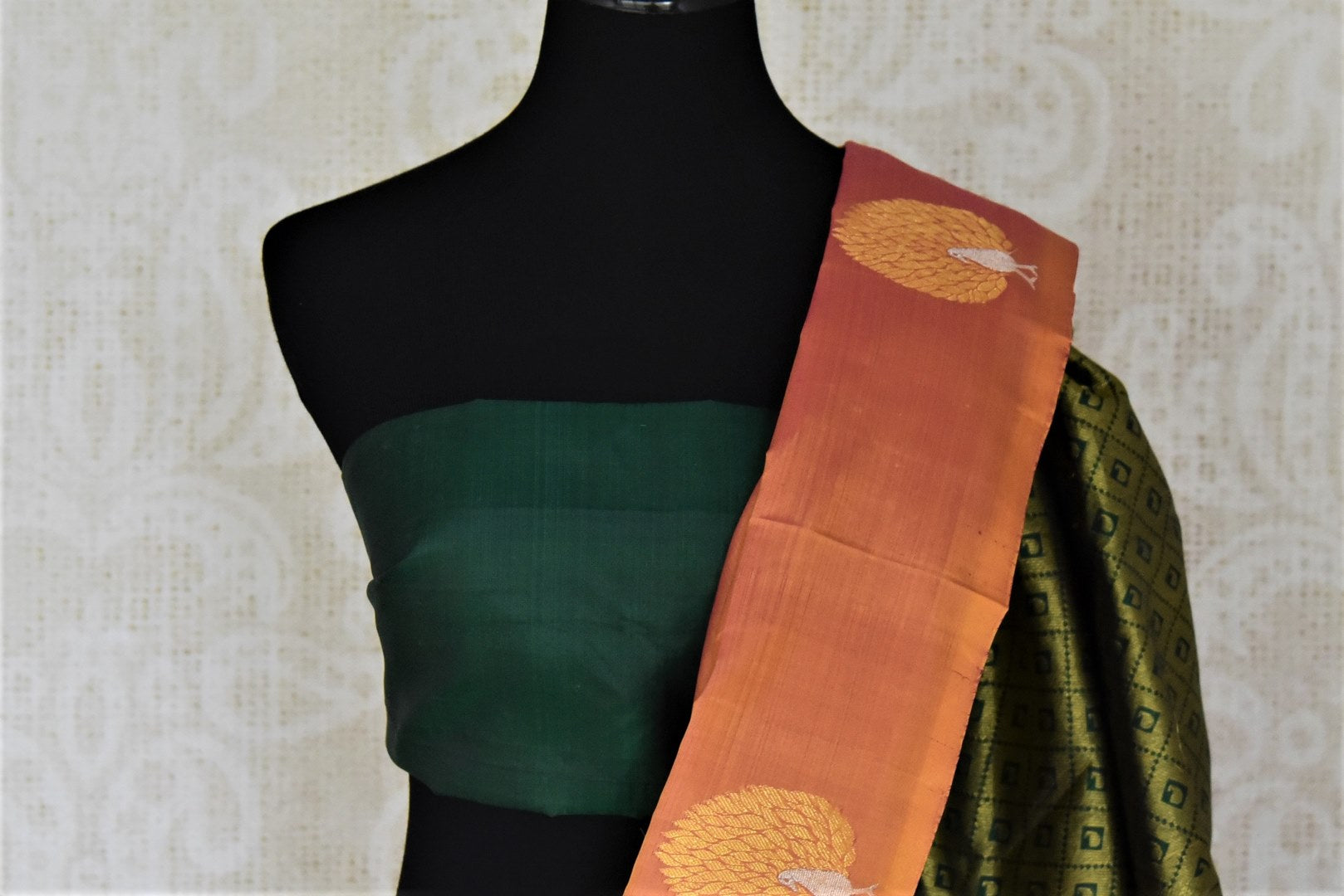 Shop beautiful golden orange borderless Kanchipuram saree online in USA with zari peacock buta and green zari pallu. Add spark to your festive style with beautiful Kanchipuram silk saris in USA from Pure Elegance Indian fashion store.-blouse pallu
