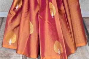 Shop beautiful golden orange borderless Kanchipuram saree online in USA with zari peacock buta and green zari pallu. Add spark to your festive style with beautiful Kanchipuram silk saris in USA from Pure Elegance Indian fashion store.-pleats