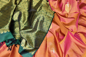 Shop beautiful golden orange borderless Kanchipuram saree online in USA with zari peacock buta and green zari pallu. Add spark to your festive style with beautiful Kanchipuram silk saris in USA from Pure Elegance Indian fashion store.-details