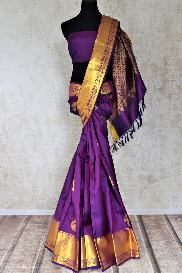 Buy beautiful purple Kanjivaram saree online in USA with golden zari border and buta. Look beautiful on weddings with exquisite Kanjivaram sarees from Pure Elegance Indian fashion store in USA. Get spoiled for choices with a myriad of pure silk sarees, Kanjeevaram saris available online.-full view