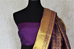 Buy beautiful purple Kanjivaram saree online in USA with golden zari border and buta. Look beautiful on weddings with exquisite Kanjivaram sarees from Pure Elegance Indian fashion store in USA. Get spoiled for choices with a myriad of pure silk sarees, Kanjeevaram saris available online.-blouse pallu