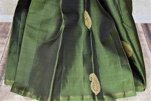 Buy bottle green borderless Kanjeevaram sari online in USA with paisley golden zari buta. Give yourself a beautiful traditional makeover this wedding season with exquisite Kanchipuram silk sarees from Pure Elegance Indian fashion boutique in USA.-pleats