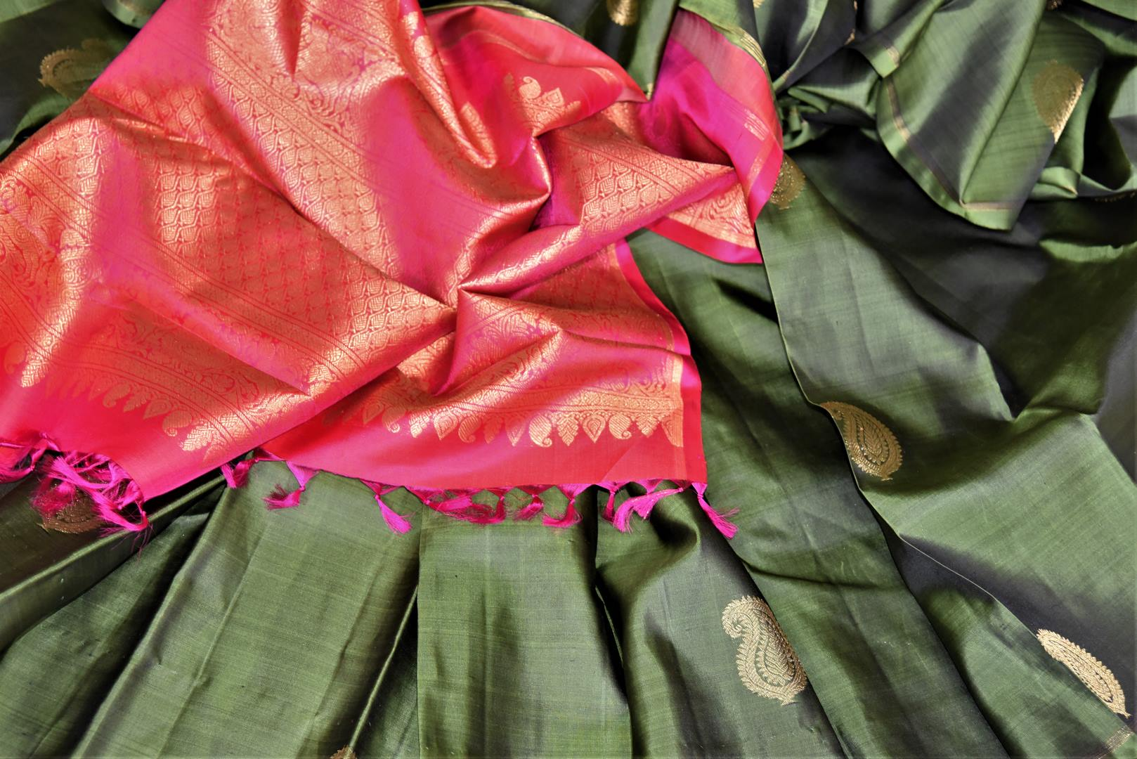 Buy bottle green borderless Kanjeevaram sari online in USA with paisley golden zari buta. Give yourself a beautiful traditional makeover this wedding season with exquisite Kanchipuram silk sarees from Pure Elegance Indian fashion boutique in USA.-details