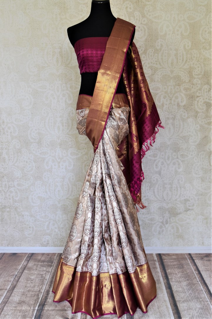Buy beige Kanjeevaram sari online in USA with silver zari buta and magenta zari border. Get spoiled for choices with a myriad of Kanjivaram silk sarees, wedding sarees from Pure Elegance Indian fashion store in USA.-full view