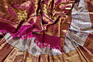 Buy beige Kanjeevaram sari online in USA with silver zari buta and magenta zari border. Get spoiled for choices with a myriad of Kanjivaram silk sarees, wedding sarees from Pure Elegance Indian fashion store in USA.-details
