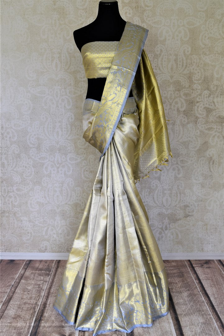 Shop exquisite powder blue and golden zari Kanjivaram saree online in USA. Look beautiful on weddings with exquisite Kanjivaram sarees from Pure Elegance Indian fashion store in USA. Get spoiled for choices with a myriad of pure silk sarees, Kanjeevaram saris available online.-full view
