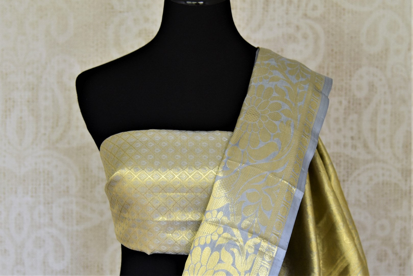 Shop exquisite powder blue and golden zari Kanjivaram saree online in USA. Look beautiful on weddings with exquisite Kanjivaram sarees from Pure Elegance Indian fashion store in USA. Get spoiled for choices with a myriad of pure silk sarees, Kanjeevaram saris available online.-blouse pallu
