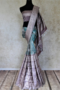 Shop heavy blue Kanjivaram saree online in USA with grey heavy zari border. Look beautiful on weddings with exquisite Kanjivaram sarees from Pure Elegance Indian fashion store in USA. Get spoiled for choices with a myriad of pure silk sarees, Kanjeevaram saris available online.-full view