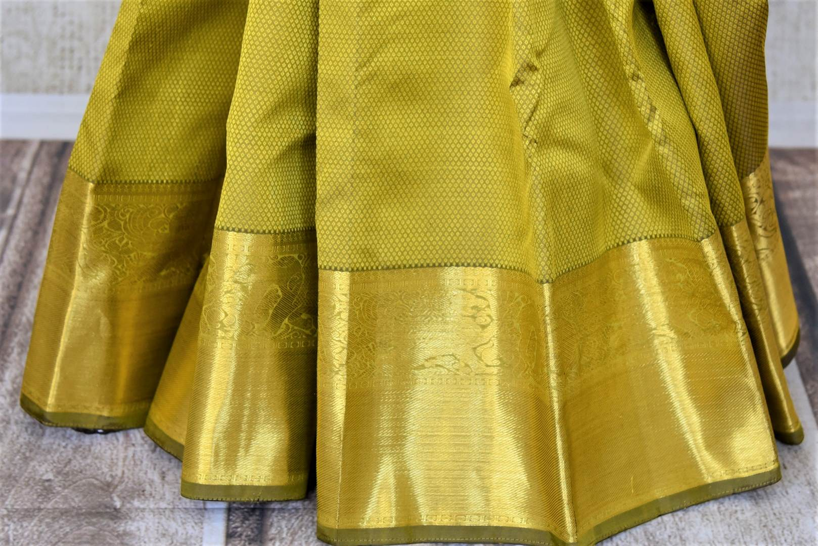 Shop mehendi green Kanjeevaram sari online in USA with golden zari border. Add spark to your festive style with beautiful Kanchipuram silk sarees in USA from Pure Elegance Indian fashion store.-pleats
