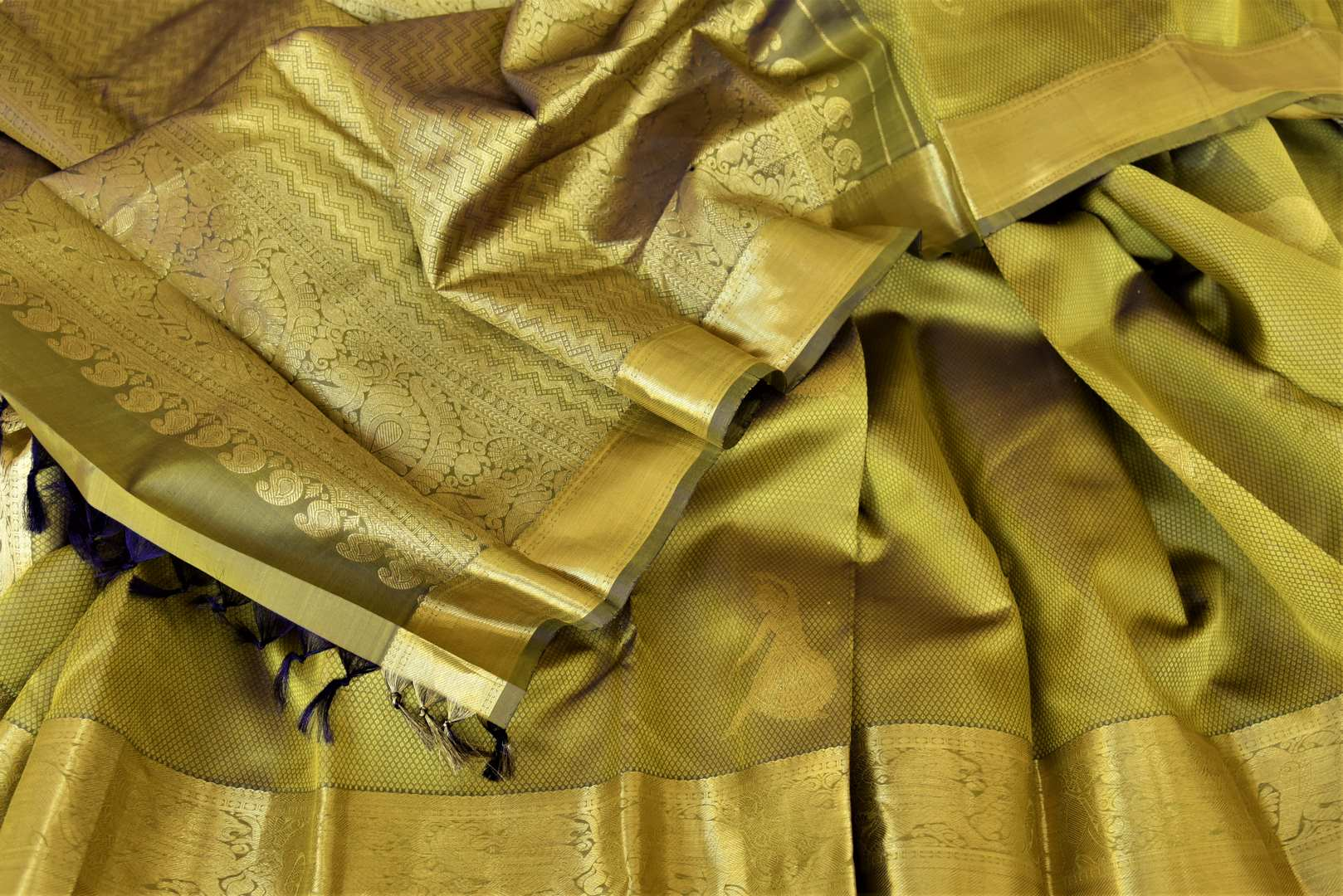Shop mehendi green Kanjeevaram sari online in USA with golden zari border. Add spark to your festive style with beautiful Kanchipuram silk sarees in USA from Pure Elegance Indian fashion store.-details